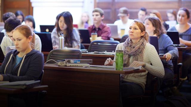 students listening to professor in classroom