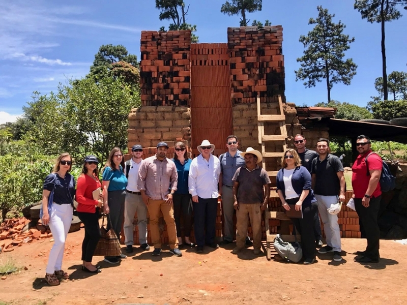 Students in front of a kiln purchased through a microfinance loan in Antigua, Guatemala
