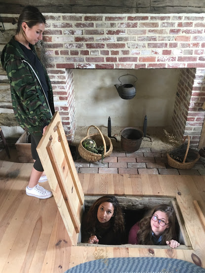 Students in a trap door in the Webb Cabin