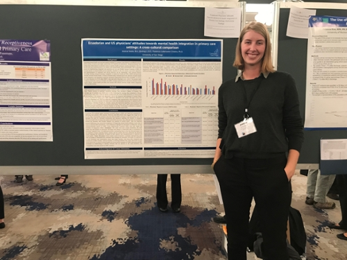 girl standing next to poster presentation
