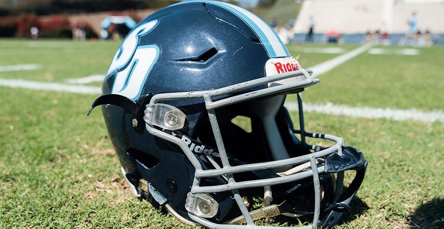 USD Football helmet on the field