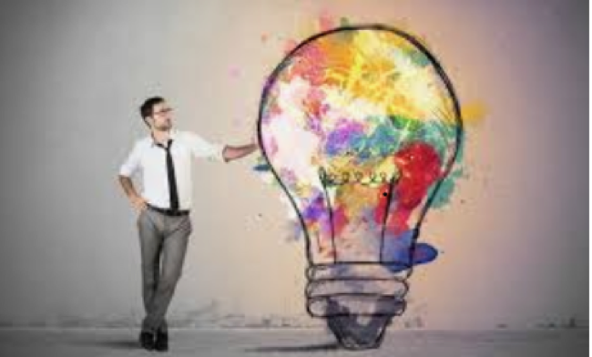 image of a man leaning against a colorful lightbulb