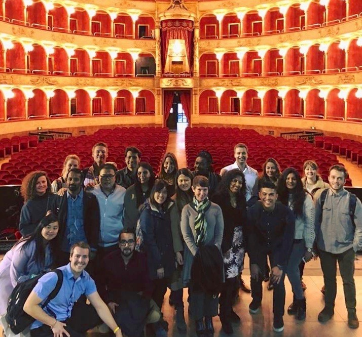 USD Professor Priya Kannan-Narasimhan and her MBA class in a classic theater in Rome