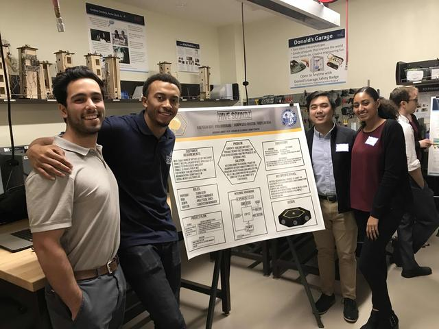 Group of students presenting a project