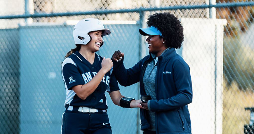 Former University of Nebraska All-American MJ Knighten, right, has been hired as the new head coach of the USD Softball program, it was announced on Aug. 28. Knighten replaces Jessica Pistole.
