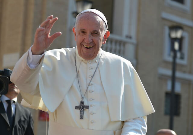 Pope Francis standing and waving