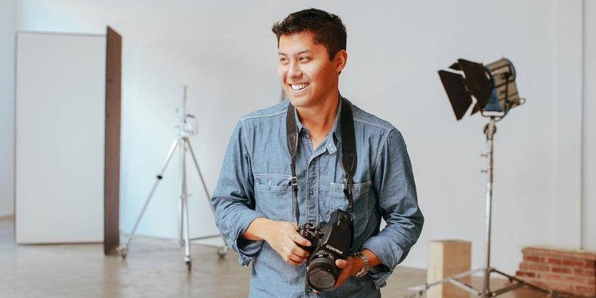 Justin Chung holding a camera