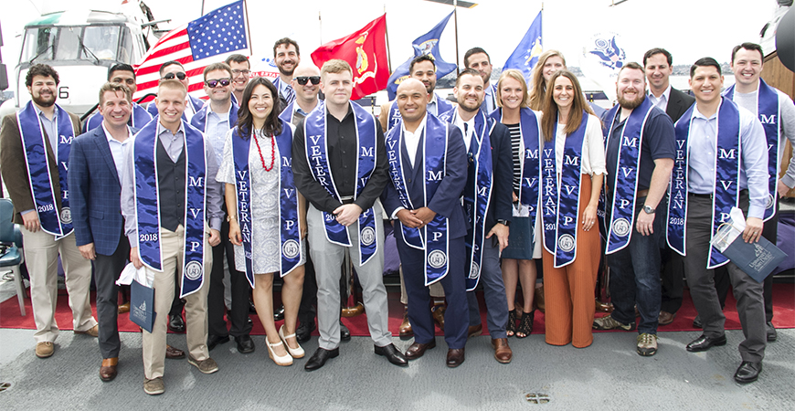 Military-connected veteran students celebrate at a 2018 graduation ceremony. A Zoom event featured recent alumni sharing their thoughts on career tips and support.