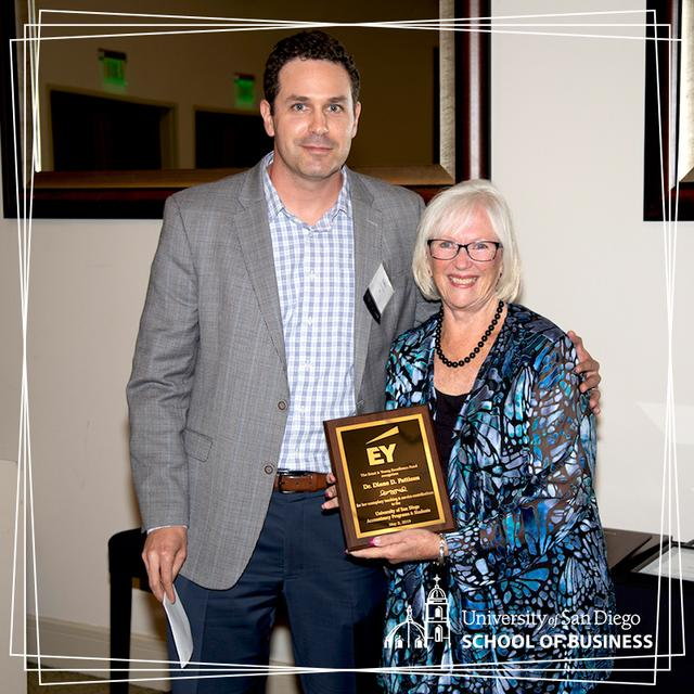 USD professor Diane Pattison receiving the Ernst & Young Excellence Fund Award