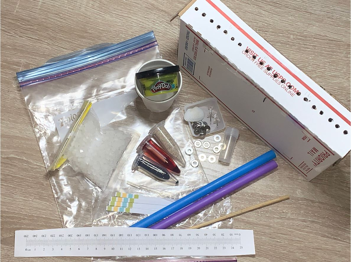 remote lab kits, including Play-Doh, straws, and vials of liquid.