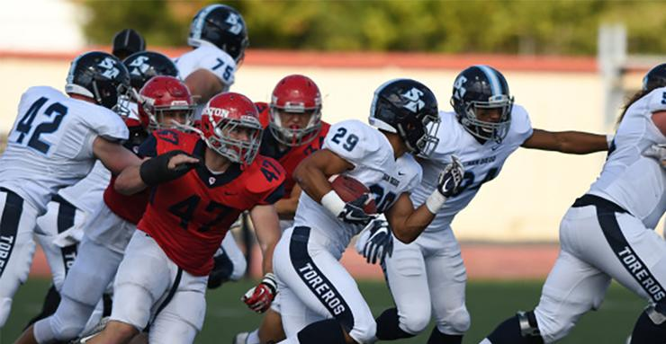 Freshman running back Emilio Martinez (29) looks for room to run during a 23-7 Toreros win at Dayton on Sept. 30.