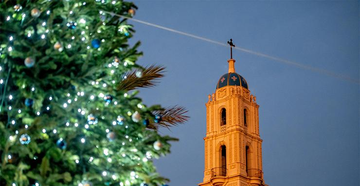 The annual ceremonial lighting of a Christmas tree at the Paseo de Colachis overlook area offers a view of The Immaculata Catholic Church. The event had carolers, candles and treats for all ages.