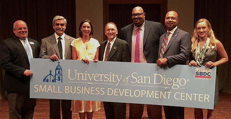 USD announced it will host a Small Business Development Center. (L to R) Jason Lemon, Jaime Alonso Gomez, Patricia Marquez, Michael Vallante, Marquise Jackson, Erik Caldwell and Karolina Rzadkowolska.