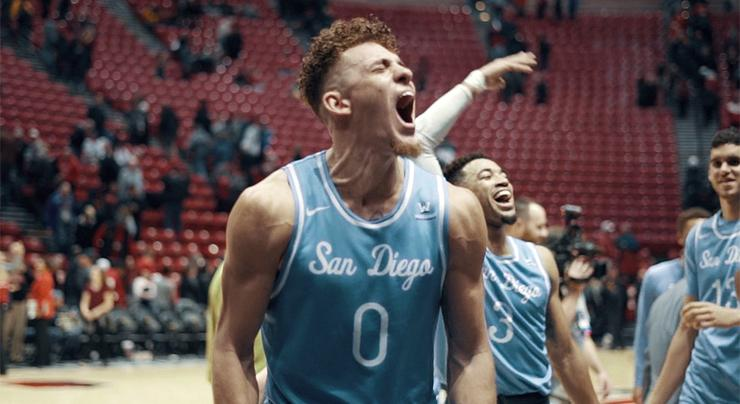 USD basketball player Isaiah Pineiro celebrates after the Toreros defeated San Diego State, 73-61, on Dec. 5. It was USD's first win at SDSU since 2000.