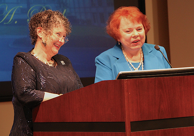 Hahn School of Nursing and Health Science Dean Jane Georges, left, and retired professor Dr. Patricia Roth enjoy a moment during the Feb. 20 Janet Rodgers Lectureship.