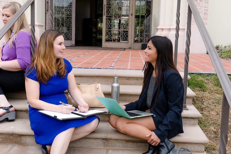 An admissions advisor speaks with a prospective MBA student at the USD School of Business