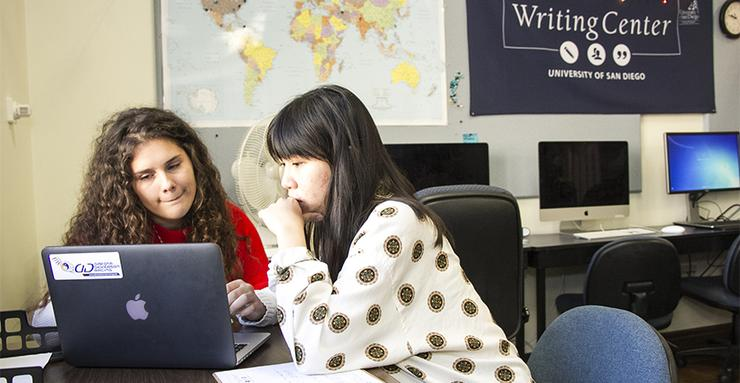 Mary Powell, left, talks about her paper with student consultant Yin Chin Casey Huang in USD's Writing Center, located in Founders Hall 190-B.
