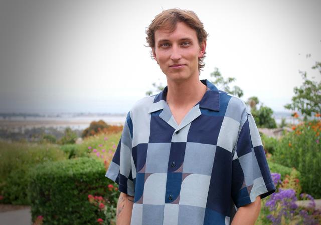 Photo of Gideon Sawyer standing in the IPJ Garden of the Sea