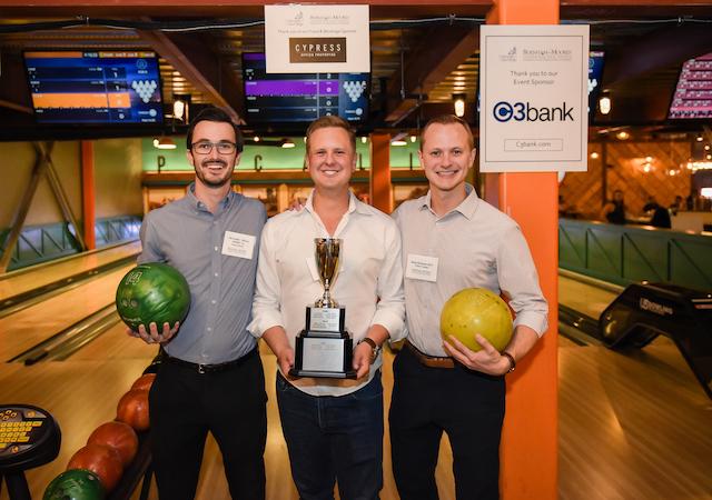 Photo is of Real Estate Alumni Winning Bowling Team
