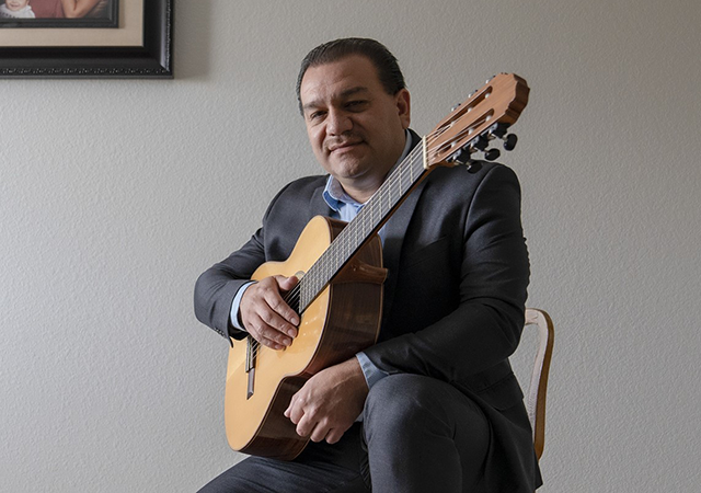 Serafin Paredes Seated with Guitar