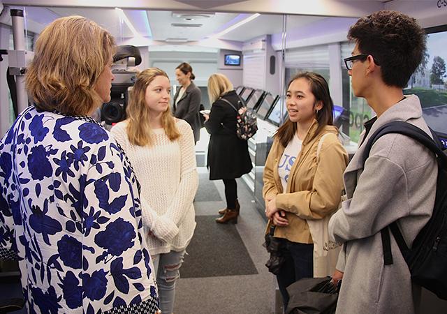 CAS Dean Noelle Norton talks with students who were aboard the C-SPAN bus on Tuesday.