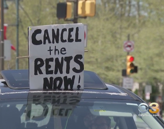 "Photo says ""Cancel the Rents Now"" Source CBS Philly.com"