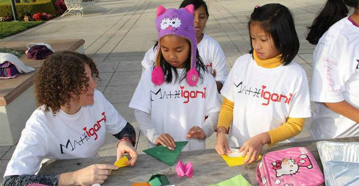 Dr. Perla Myers, far left, works with local schoolchildren during a session for Mathigami. Myers and other USD faculty received an NSF grant for their STEMWoW project.