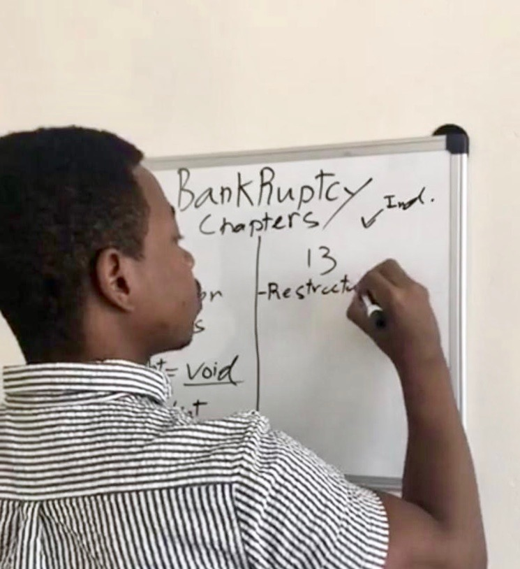 University of San Diego MBA student, Carl Dumesle, writes a business concept on a whiteboard