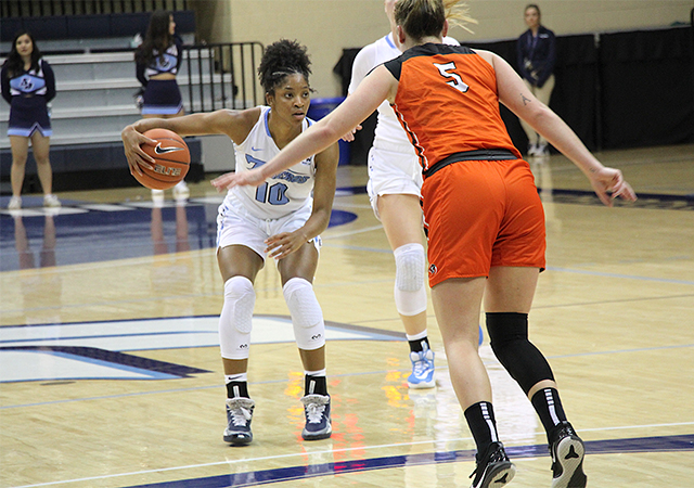 Myah Pace looks for an opening during Feb. 13 home game against Pacific. The USD women's basketball team has four straight games.