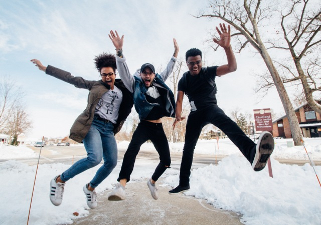 Three teens jumping in the air
