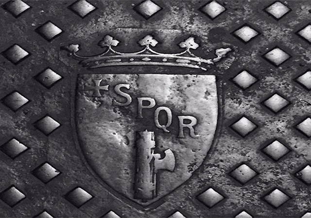Ancient metal shield with crest that has the letters SPQR, SPQR which was an abbreviation for Senatus Populusque Romanus.