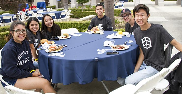 Members of the Fall 2018 first-year undergraduate class, considered the largest in university history, enjoy a welcoming barbecue earlier this month on campus.