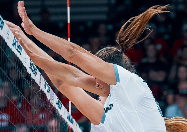 Megan Jacobsen, front, and Grae Frohling (foreground) seek a block during a WCC home match win against San Francisco. The Toreros had 17 blocks.