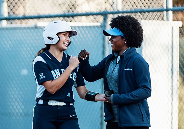 MJ Knighten, right, celebrates a hit during the 2020 USD softball season.
