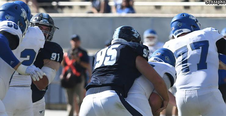 Senior defensive end Jonathan Petersen (95) sacks Drake quarterback Grant Kraemer during USD football's 45-15 win on Nov. 4. Petersen became USD's all-time sacks leader on this play.