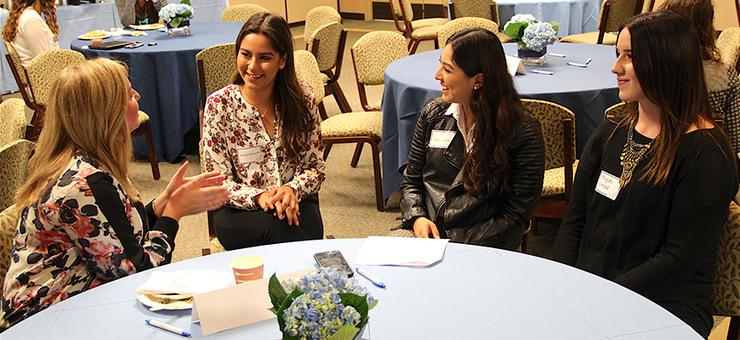 Students interact with USD 2011 alumna Allison Spalding, far left, during the USD Student Alumni Association's annual Take a Torero to Lunch event on April 4.