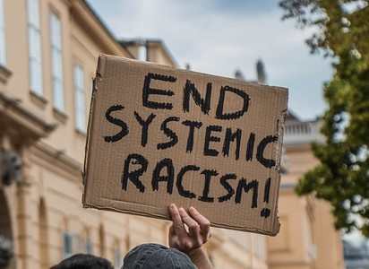 End Systemic Racism sign
