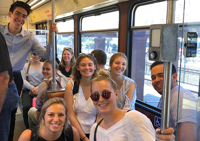 Students in ETLW 403 Environmental Management take the San Diego Metro Trolley during a fall semester field trip.