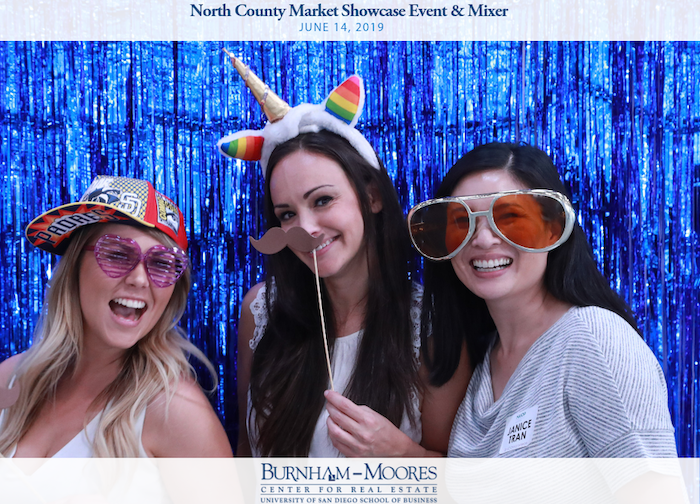 NAIOP North County Mixer. Photo is of four women in photo booth