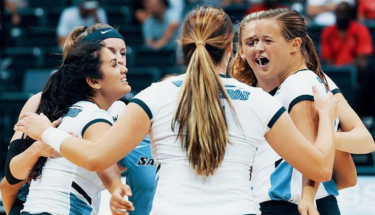 The USD women's volleyball team celebrates after scoring a point during a recent match. The team has won seven straight heading into Tuesday night's home match vs. Pepperdine.