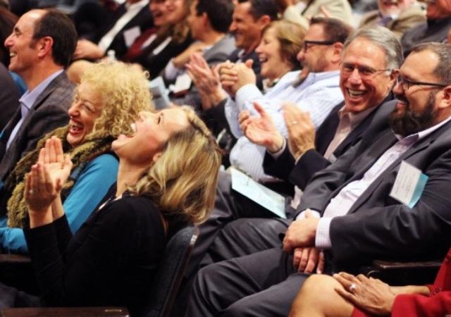 laughing crowd in auditorium