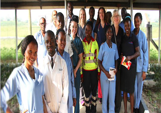 USD faculty members and student, Ugandan medical workers