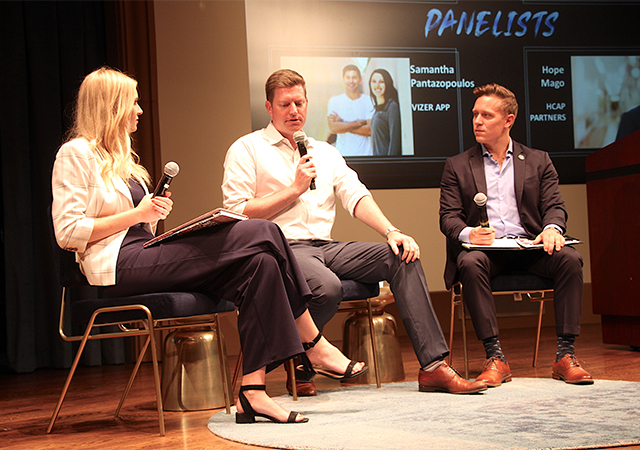 Curtis Chambers '19, center, speaks during the USD Entrepreneurship Legacy Conference on Sept. 26. He is flanked by two student interviewers.