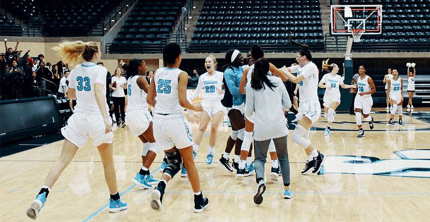 The USD women's basketball team celebrates after rallying for a fourth-quarter win against Santa Clara, 50-47, on Jan. 23 in the JCP.