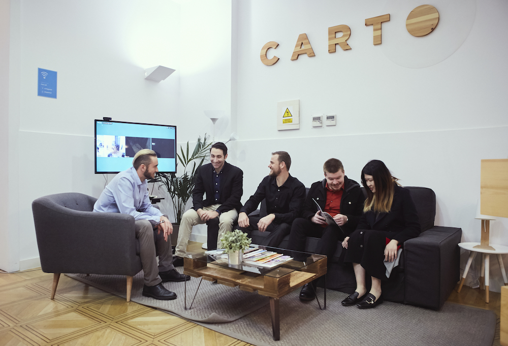 Master's in business analytics students work together at Carto in Madrid, Spain.
