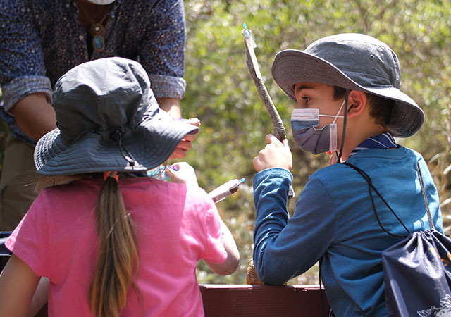 A student participating in the STEAM Forest School