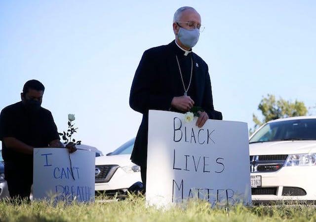 Bishop Seitz holding a Black Lives Matter Sign