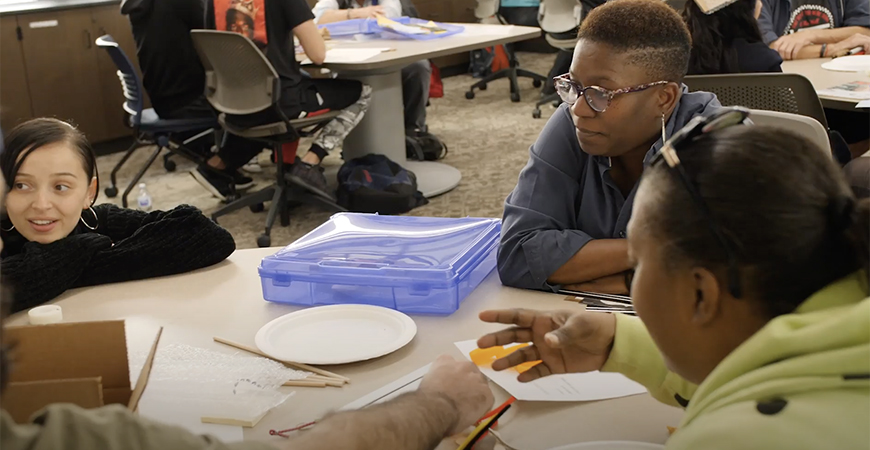 Students work with a member of the Blind Community Center during a Fall 2019 class meeting.