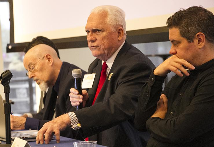 Dr. Gordon Romney, director of USD's Center for Cybersecurity, Engineering and Technology, makes a point during a panel discussion.
