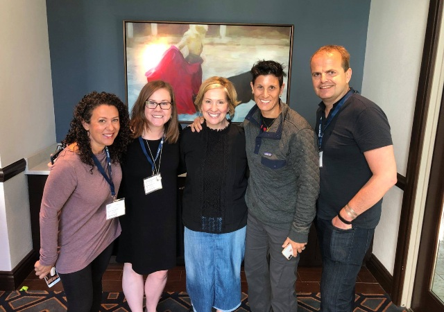 Conscious Leadership Academy Director, Lorri Sulpizio, with Brene Brown and two others smiling into the camera